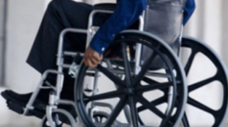 Side view of man in wheelchair